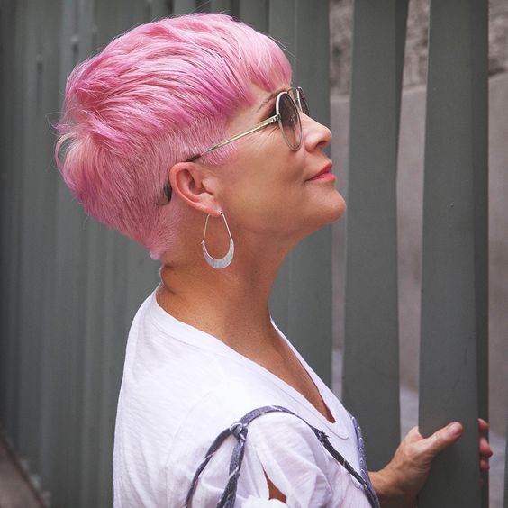 Mature woman with cotton pink pixie hair