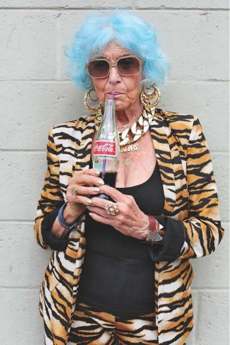 Mature woman with animal print outfit and blue hair