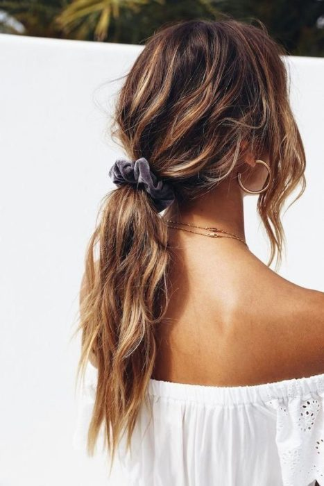 Tousled low ponytail girl with a scrunchie
