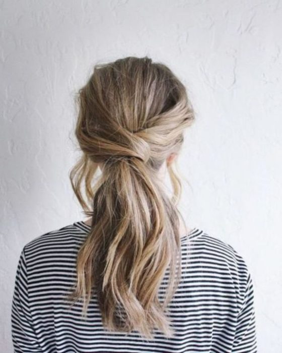Blonde girl with tousled low ponytail