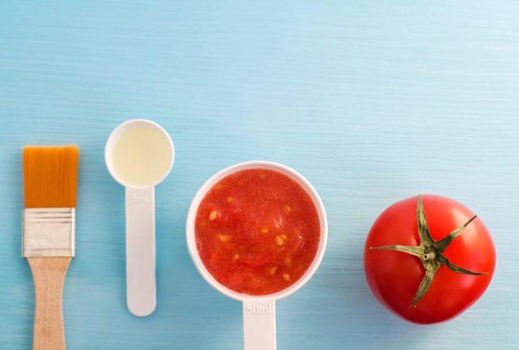 Fresh and pure tomato in a white ceramic bowl