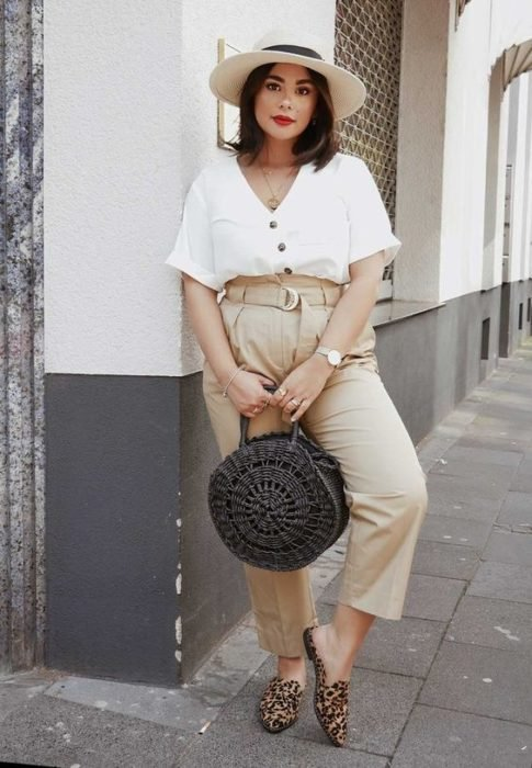 Curvy girl with wide beige pants and white blouse
