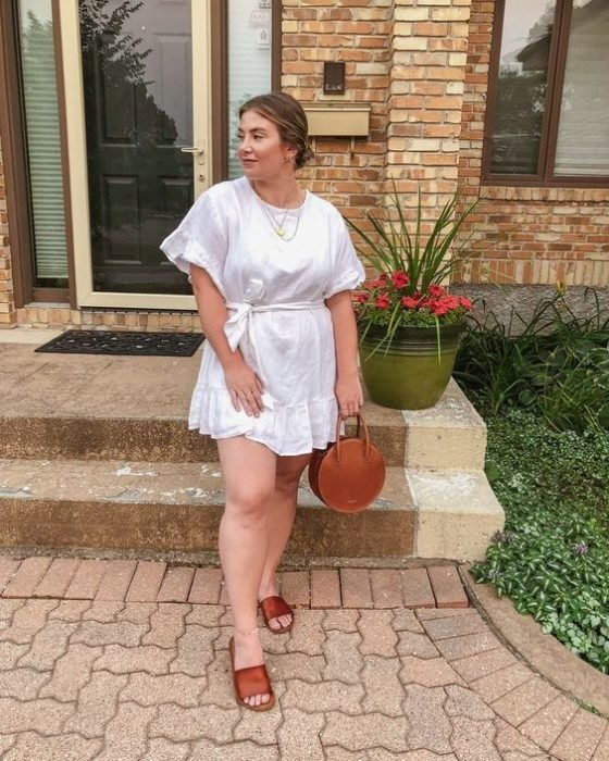 Curvy girl in white loose dress