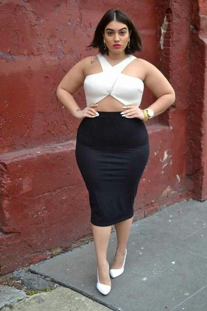 Curvy girl in black pencil skirt and white sexy blouse
