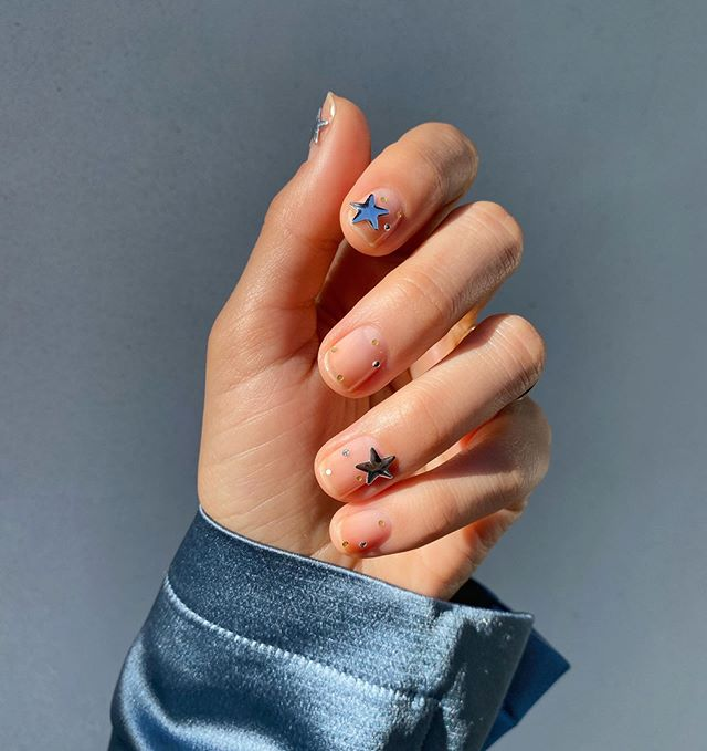 Betina Goldstein Nail Designs with Big Stars on Middle Finger and Index