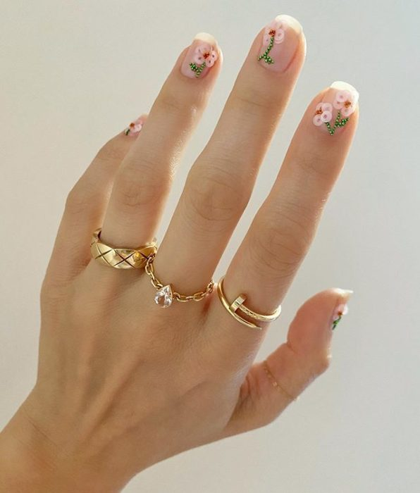Betina Goldstein Nail Designs with Flowers and Pink Glitter