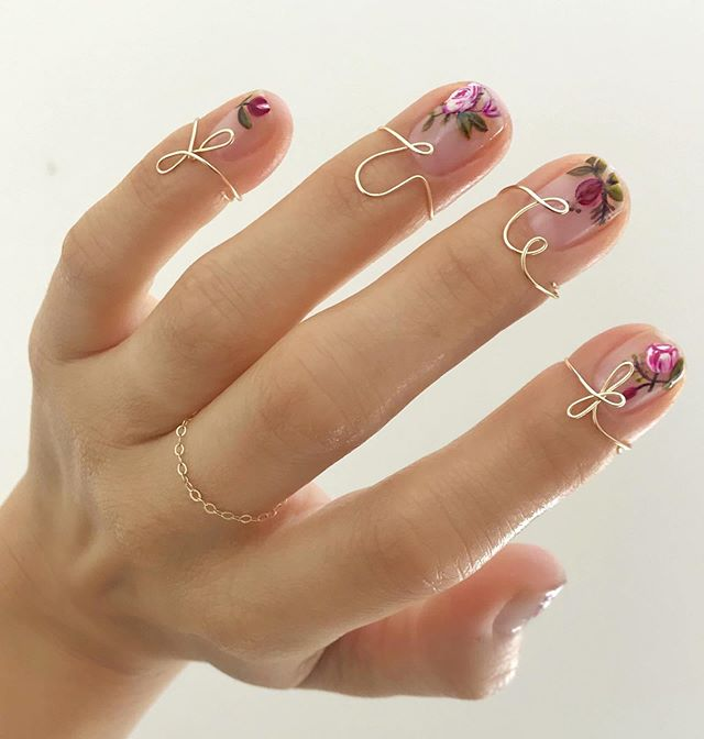 Betina Goldstein Nail Designs with Purple and Pink Flowers