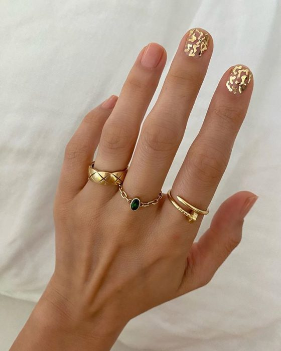 Betina Goldstein Nail Designs with Small Gold Stars Only on the Index Finger