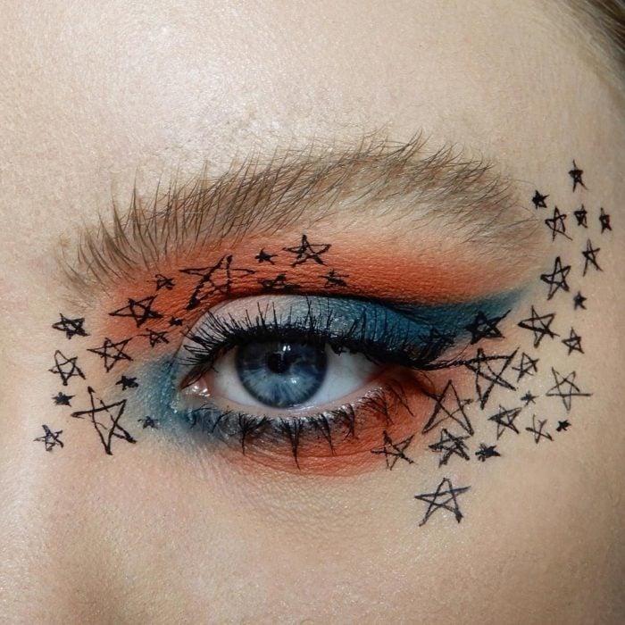 Maquillaje galáctico con tonalidad ladrillo y azul