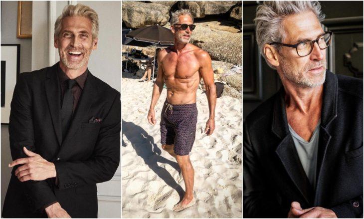 Anton Nilsson pasenado en la playa sin camisa