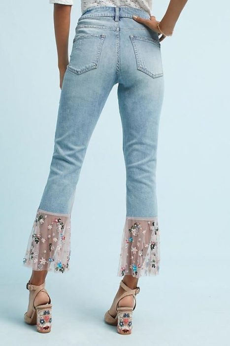 Jeans decorated with floral lace on the cuffs