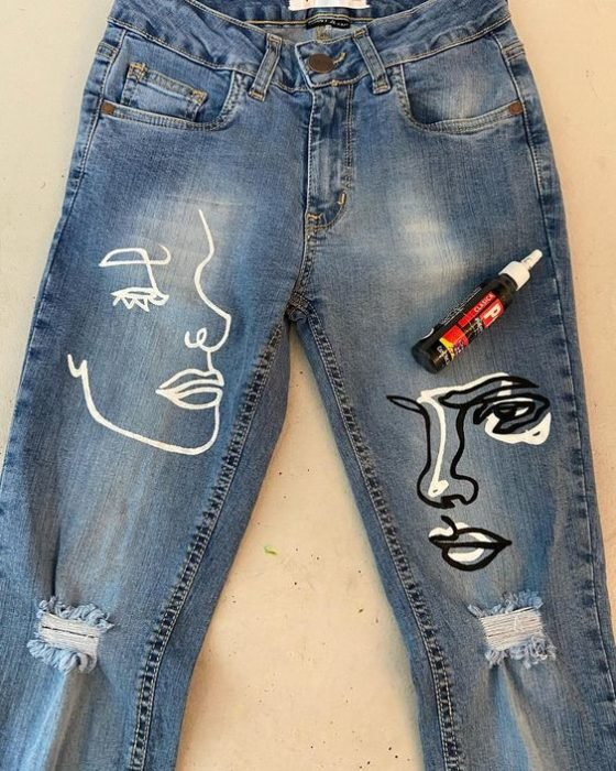 Jeans decorated with minimalist style facial silhouettes