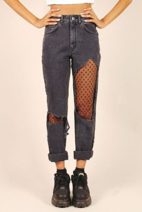 Ripped jeans with black dot lace as lining