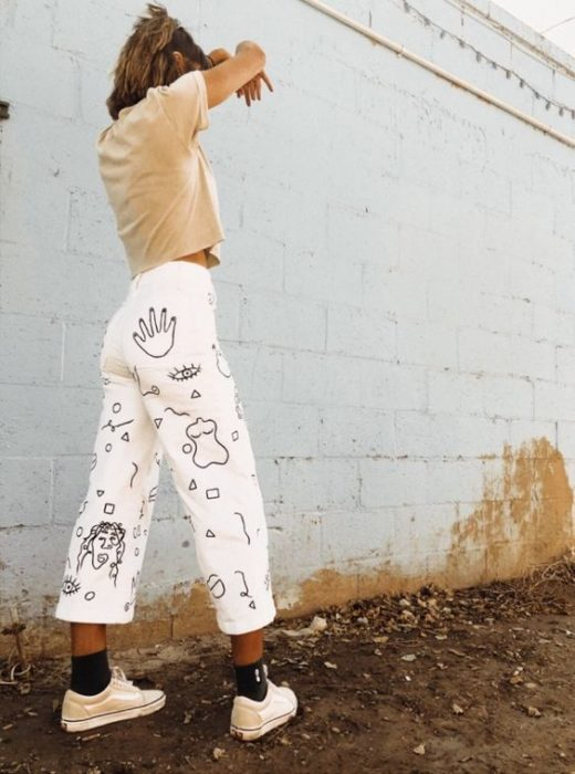 White pants decorated with black paint silhouettes