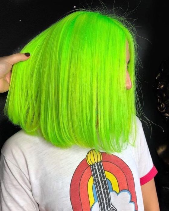 Girl with short neon green hair