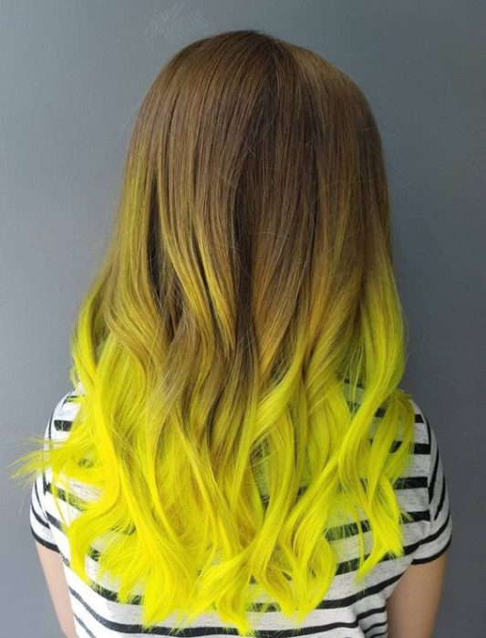 Long brown hair with neon green tips