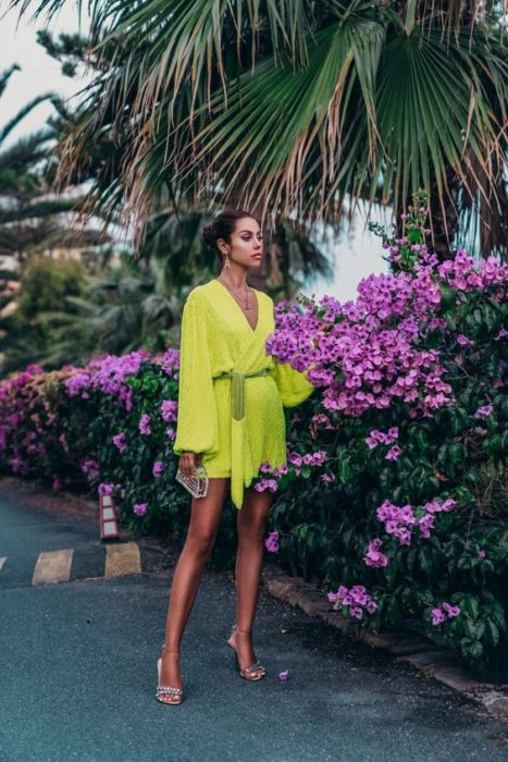 Girl in baggy neon green dress