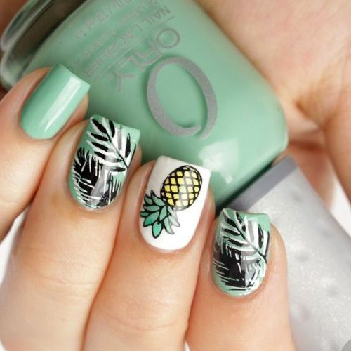 Manicure in mint color with pineapple decoration and green flowers