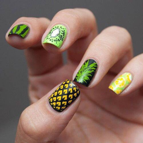 Manicure in green tone with black lines decorated with yellow pineapple