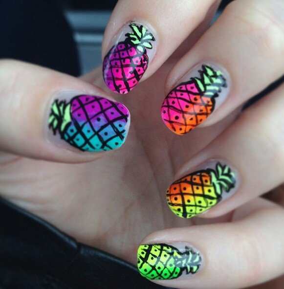 Manicure in neon blue, purple, yellow and green colors in the shape of a pineapple