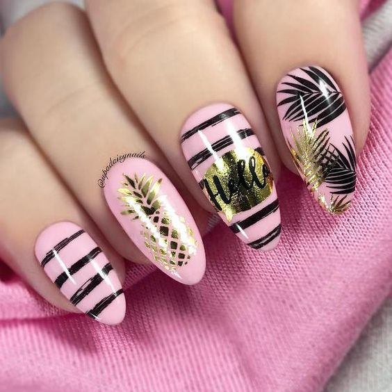 Pastel pink manicure with black outline effects and pineapple decoration