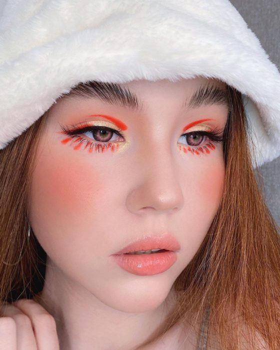 Eye makeup with orange and white shades