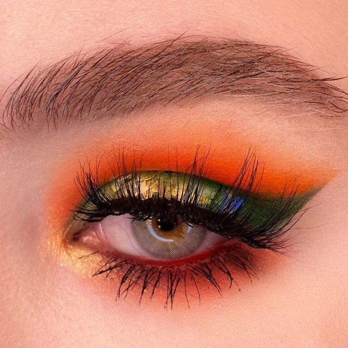 Eye makeup with shades of orange and green