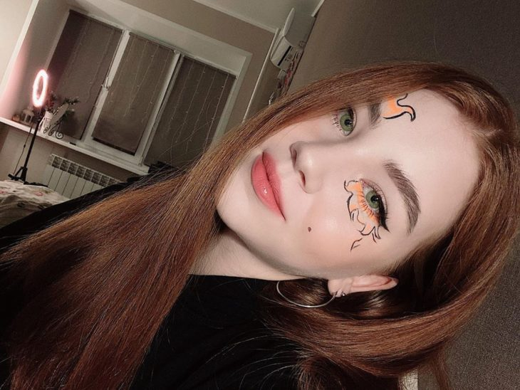 Eye makeup with shades of orange and black