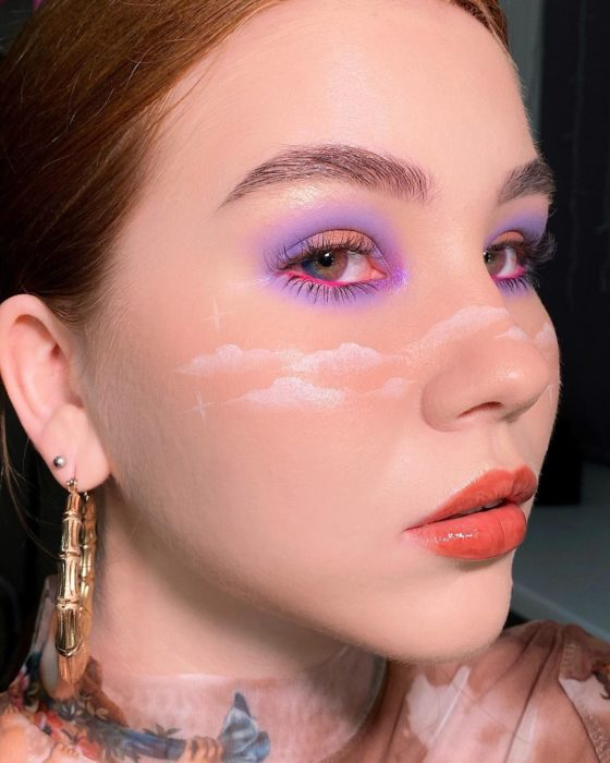 Eye makeup with lilac and pink shades and clouds
