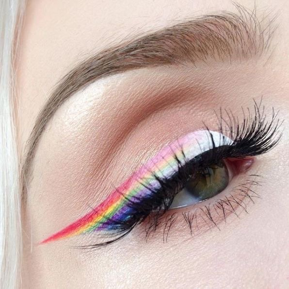 Rainbow outline in blue, purple, yellow, orange, pink and white colors