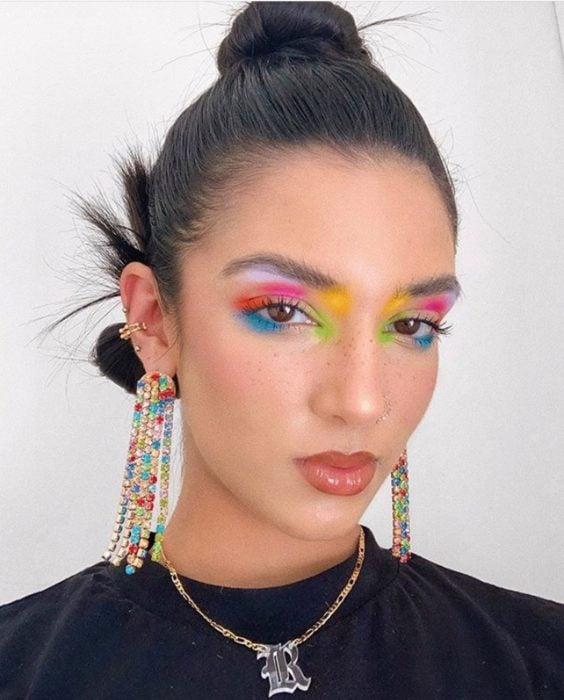 Rainbow makeup in blue, purple, yellow, orange, pink shades for eyelids