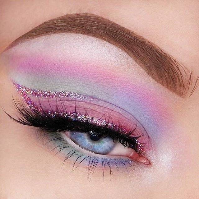 Rainbow makeup in pastel pink, green, purple and blue