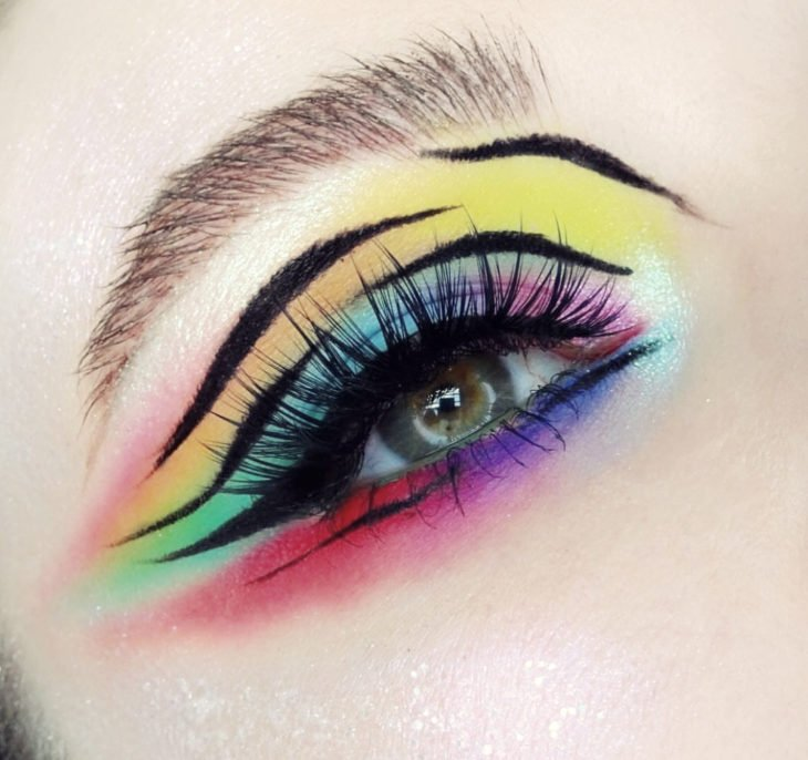 Rainbow makeup in blue, purple, yellow, orange, pink colors with animal print effect in black outlined