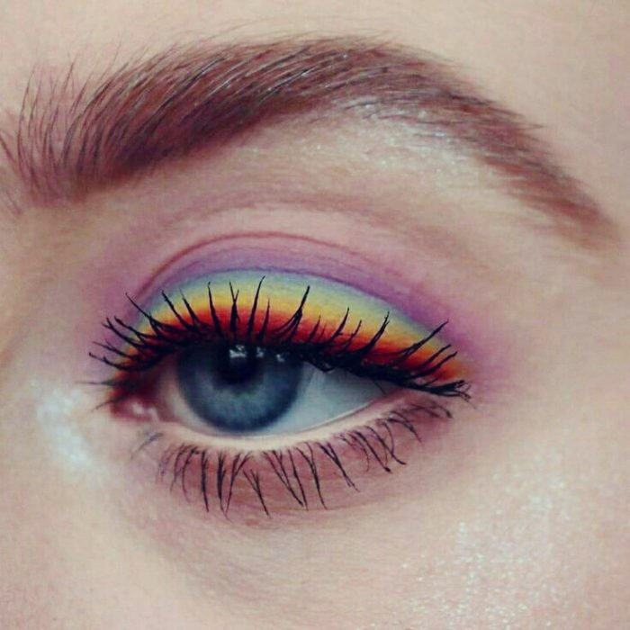 Rainbow makeup in blue, purple, yellow, orange, pink colors