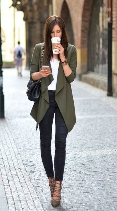 Woman with jeans, white blouse and military green cardigan