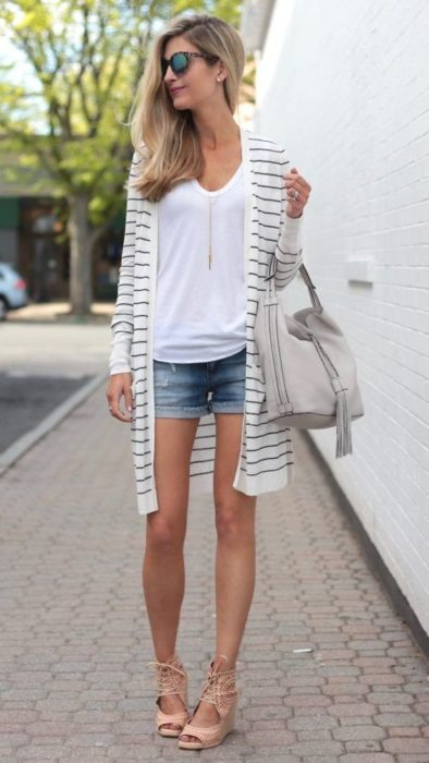 Blonde girl with gray striped white cardigan and denim shorts