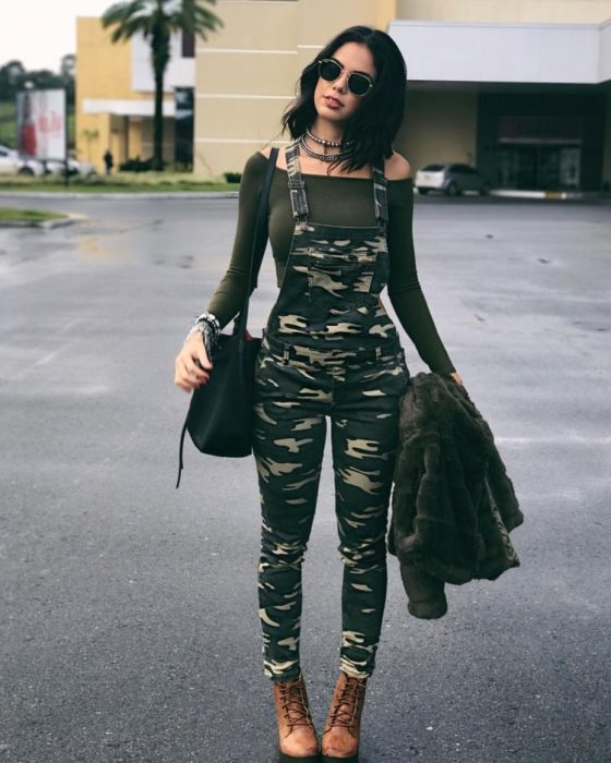 Girl wearing army green overalls along with a green top