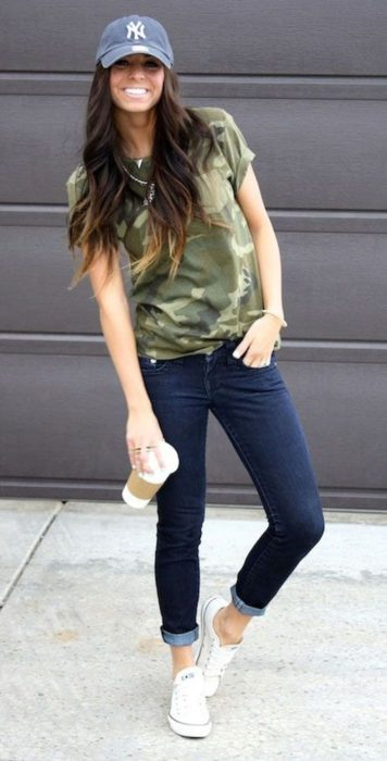 Girl wearing an army green blouse