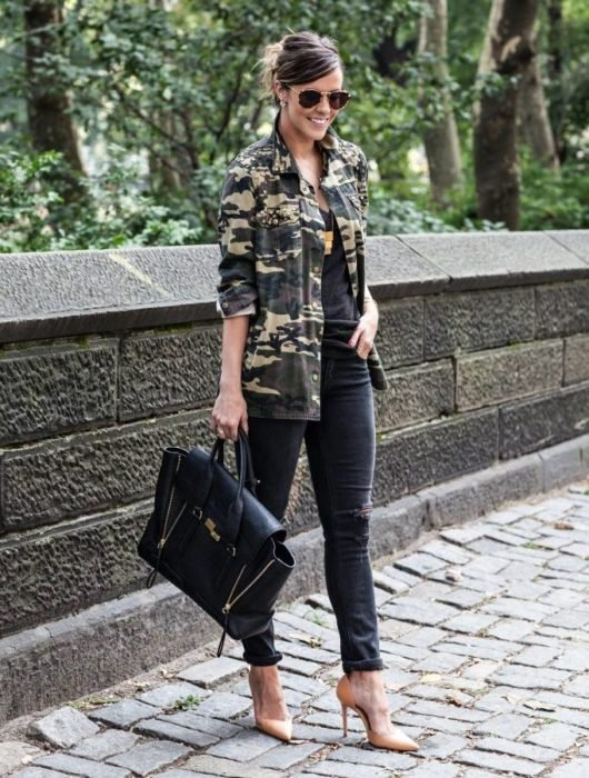 Girl wearing an army green jacket