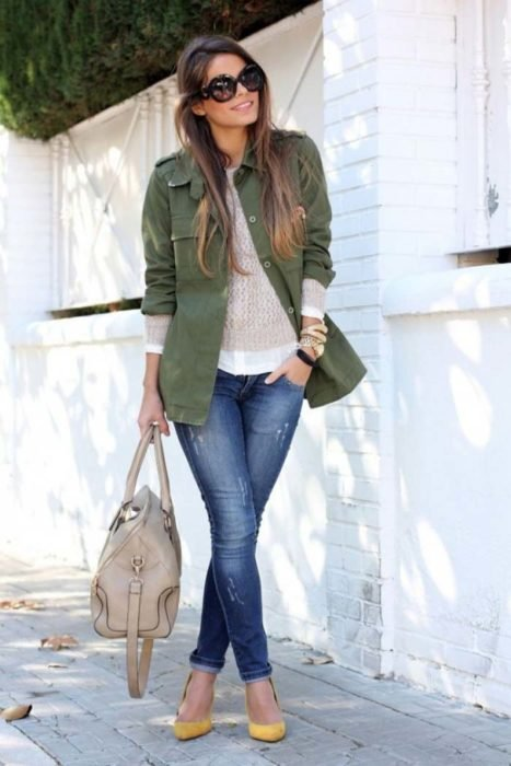 Girl wearing jeans with military green jacket