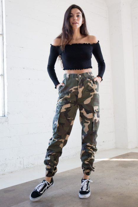 Girl wearing army green pants with a black top