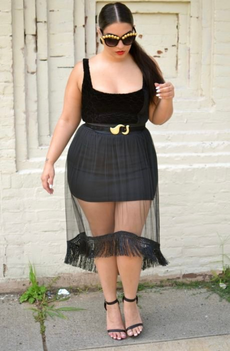 Curvy Girl Wearing A Sheer Bodycon Skirt With Transparency And A Black Blouse