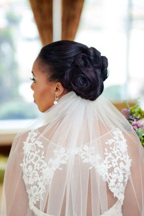 High wedding updo with veil