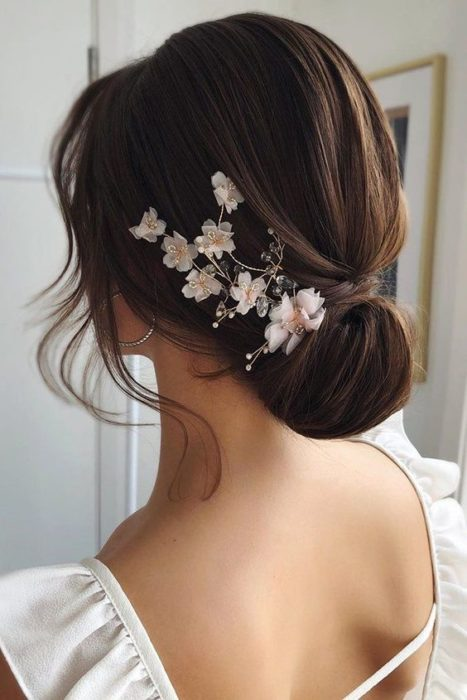Low bridal updo with floral headdress