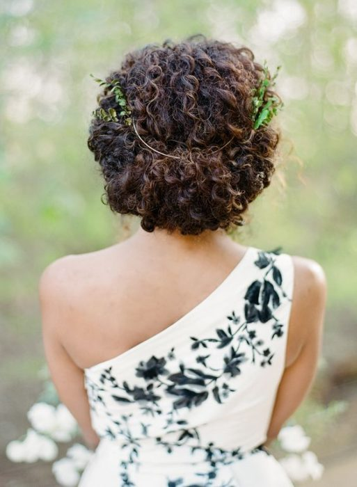 Updo for curly hair bride with plant headdress
