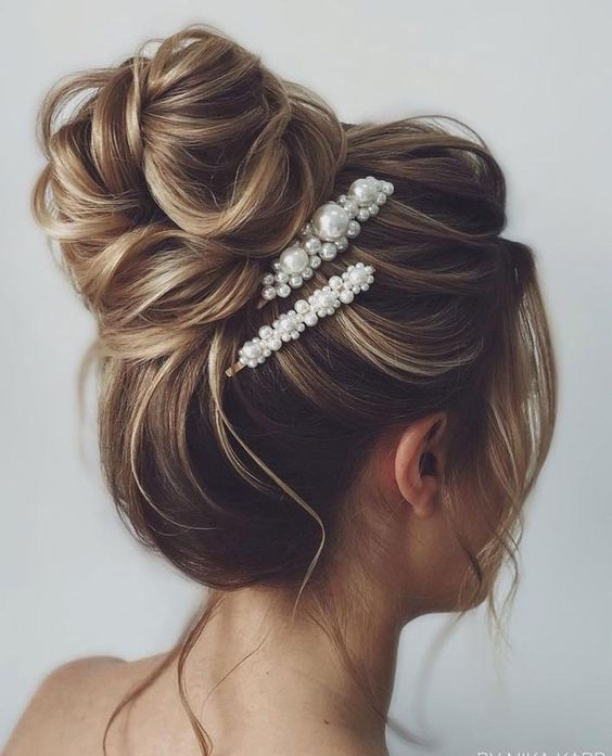 High bridal updo with pearl brooches