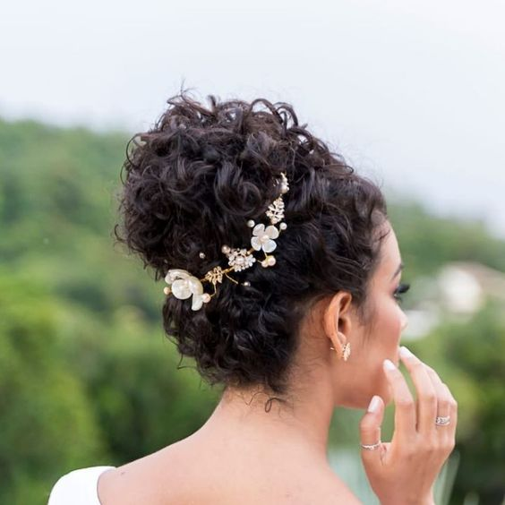 Curly hair bride with high updo