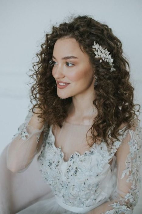 Curly hair bride with side headdress