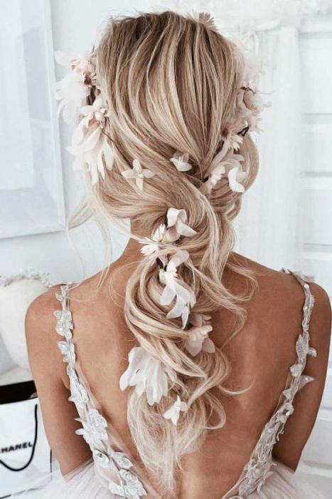 Loose wedding hairstyle with flowers