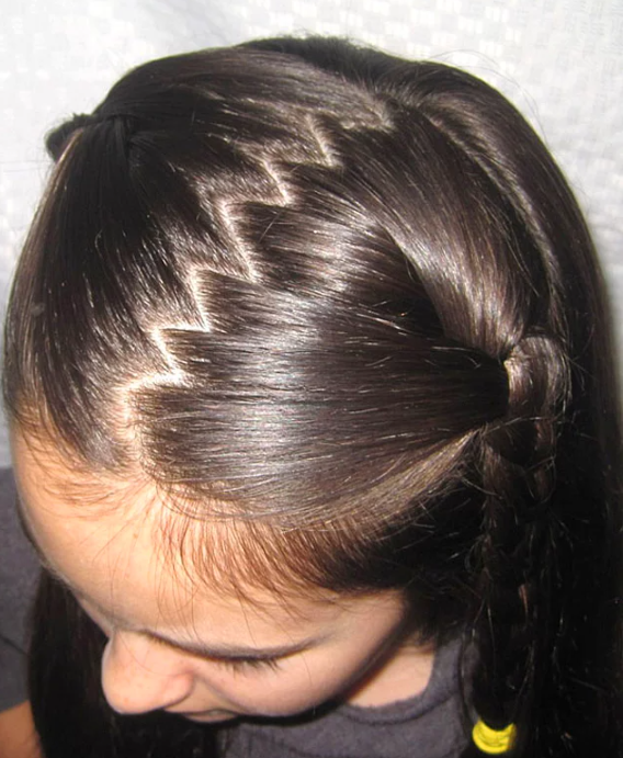 Girl with zigzag hair parting